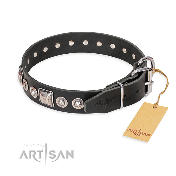 Natural genuine leather dog collar made of gentle to touch material with reliable decorations